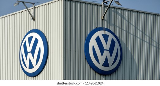 Brunswick, Lower Saxony, Germany - April 15, 2018: Production hall of the Volkswagen factory with two VW logos on the outer wall of the building