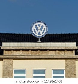 Brunswick, Lower Saxony, Germany - April 15, 2018: Upper part of the Volkswagen administration building with a large VW logo on top