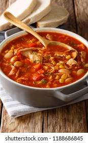 Brunswick Stew stew with vegetables, on chicken broth and barbecue sauce with seasonings close-up in a pot on the table. vertical