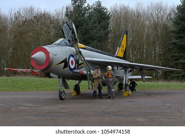 BRUNTINGTHORPE, LEICESTERSHIRE, UK - FEBRUARY 20, 2016: The pilot of English Electric BAC Lightning F3 XR713, in 111 Squadron markings from RAF Leuchars in Scotland, carries out an aircrew debrief.