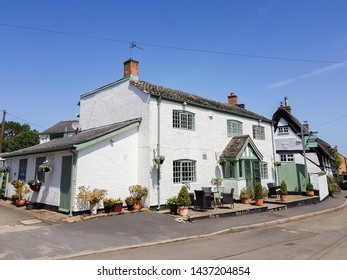 Bruntingthorpe, Leicestershire / UK - June 28th 2019: An attractive, whitewashed building houses the Joiners Arms restaurant that has kept the Michelin Guide Bib Gourmand status for five years.