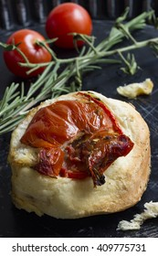 Bruscette with stewed tomato and rosemary