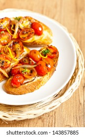 Bruschetta with baked cherry tomatoes and onion