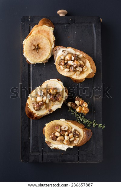bruschetta with cheese, apple and walnuts. Vertical image.