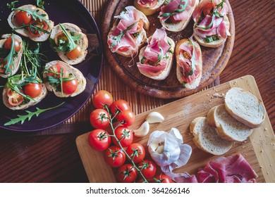 Bruschetta with cherry tomatoes, prosciutto, garlic, olive oil