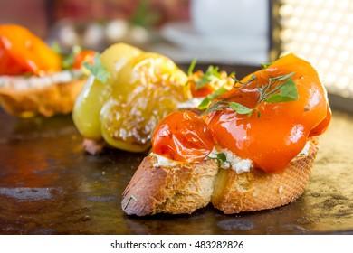 Bruschetta with cherry tomatoes, sweet pepper, mozzarella cheese and marjoram.