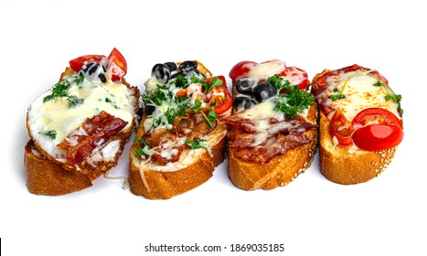 Bruschetta with different fillings on a white background. Vegetables, meat and cheese bruschetta. High quality photo