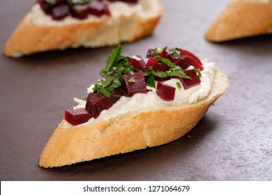 Bruschetta with farmers cheese horseraddish beetroot and parsley in back lit