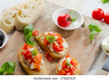 Bruschetta  with fresh tomatoes, cheese and basil. Selective focus