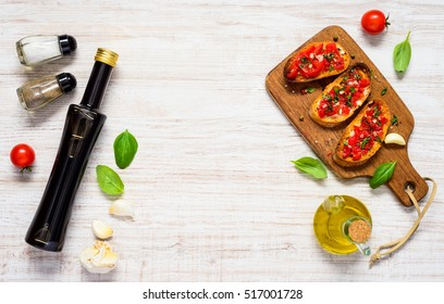 Bruschetta Italian Cuisine with Balsamic Vinegar, Salt, Pepper and Tomatoes in Top view with Copy Space Text Area