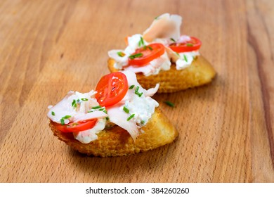the bruschetta juicy tomatoes on fresh bread pesto as topping