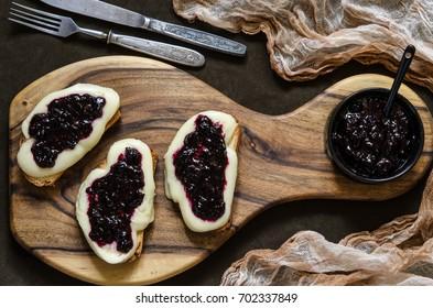 Bruschetta with mozzarella and black currant chia jam