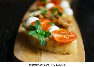 bruschetta with mozzarella cherry tomatoes and Basil, bruschetta with tuna