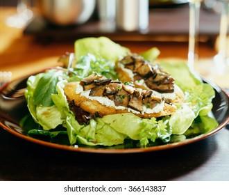 Bruschetta on green salad