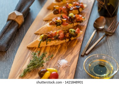 bruschetta on italian bread with olive oil on the side