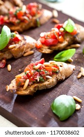 bruschetta, on slices of toasted baguette garnished with basil
