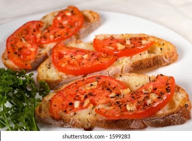 Bruschetta on white plate.