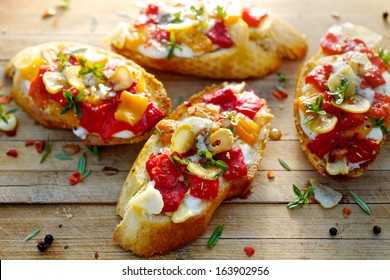 Bruschetta with roasted bell pepper, goat cheese, garlic and herbs