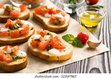 Bruschetta with roasted tomatoes, mozzarella cheese, garlic and basil