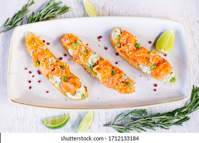 Bruschetta with salmon.  Bruschetta with trout.  Bruschetta with red fish. Small sandwiches with seafood