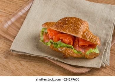 Bruschetta sandwich with fish salmon. Homemade fast food recipe dishes. Top view, overhead. Rustic background.