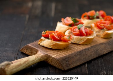 bruschetta set on vintage wooden board