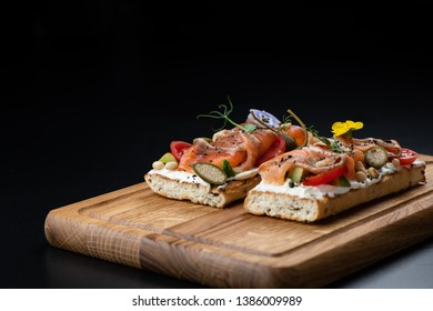 bruschetta and tapas on a black background