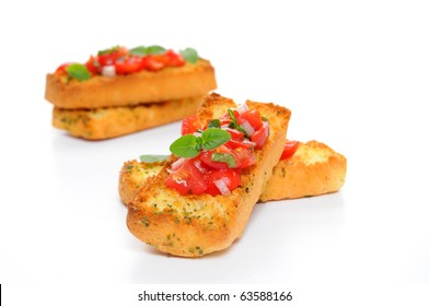 Bruschetta with tomato and fresh herbs on a white background.