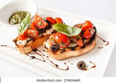 Bruschetta with tomato, mozarella and basil
