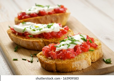 Bruschetta with tomato, mozarella and chive