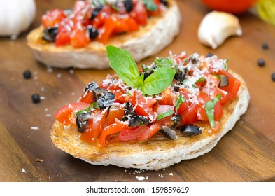 bruschetta with tomato, olives, basil and cheese horizontal close-up