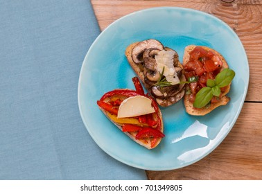 Bruschetta with tomatoes, mushrooms, goat's cheese.