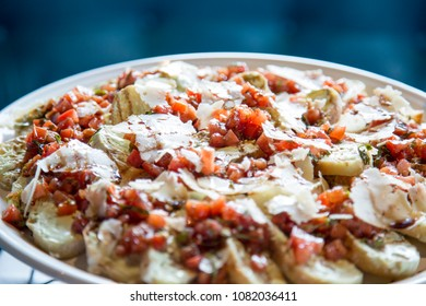 bruschetta with tomatoes and parmesan on plate