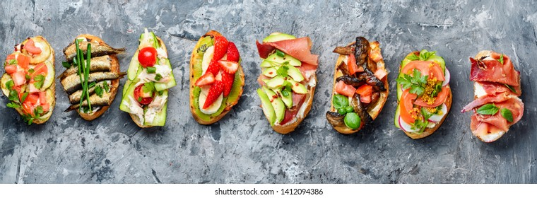 Bruschetta with various toppings.Assortment of italian traditional bruschetta.Summer party.Mix bruschetta