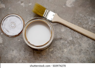 brush and bank of white paint