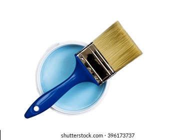 Brush and blue paint jar with a close-up on a white background top view