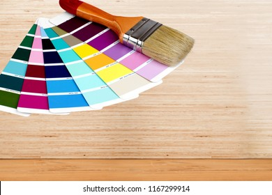 Brush and bright palette of colors isolated on background