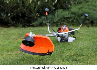 Brush cutter handles in the grass