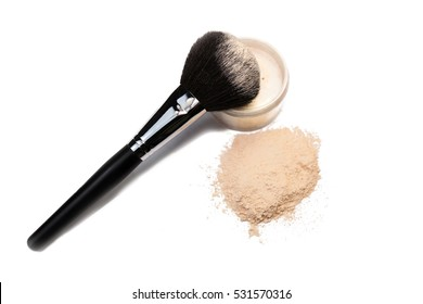 brush for a make-up on a powder box and in the scattered powder.