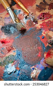 Brush and oil paint artist shot closeup