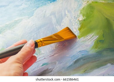 Brush on a colored background, painted oil