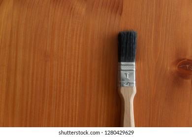 Brush on wooden background
