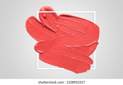 brush and paint texture on paper with geometric frame , living coral. Color of the year 2019. living coral