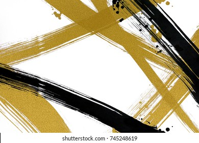 Brush painted black ink line & drops on white background