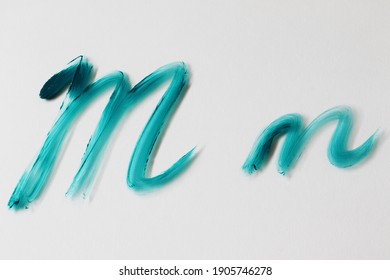 """brush painted turquoise letter """"m"""""""