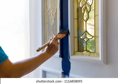 Brush painting house front door with blue paint at home do it yourself project