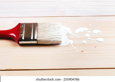 Brush painting wooden furniture with white color, close up