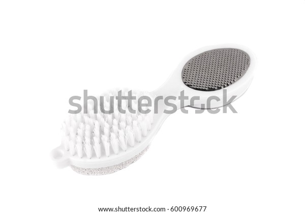 Brush and pumice stone for care of legs isolated on white background. Hygiene of the feet.
