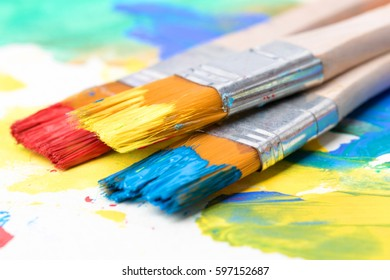 Brush the rainbow splash art project. Strokes are messy in a white isolated background.
