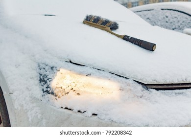 Brush for snow cleaning on the hood of a snow covered car